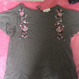 Shirt sleeve flower shirt